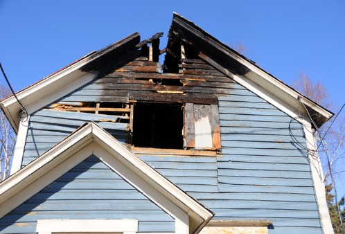 The outside of a home after a fire, soon to need Fire Damage Restoration