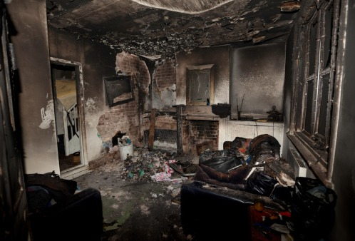 A living room in the aftermath of a fire, needing fire damage restoration