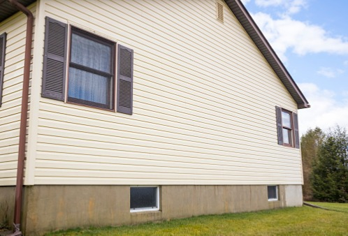 The side of a home after restored by a siding contractor
